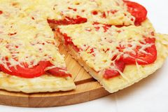 Pizza with a slice removed Royalty Free Stock Photos