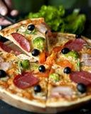 Pizza Slice. With salami, broccoli, tomato, olives stock photography