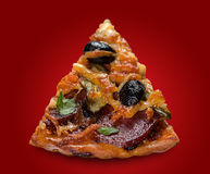 Pizza slice with sausage. Pizza with sausage on red royalty free stock photography