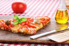 Pizza slice served on rustic wooden board Royalty Free Stock Image