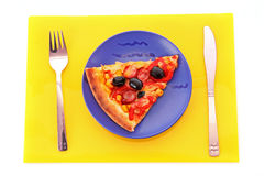 Pizza slice on the table Stock Images