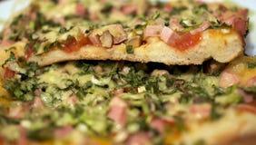 Pizza sliced stock photo