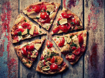 Pizza slices on grunge wooden table Royalty Free Stock Images