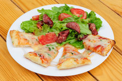 Pizza slices and salad Stock Image