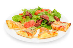 Pizza slices and salad Stock Photography