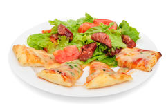 Pizza slices and salad Stock Photo