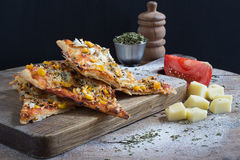 Pizza Slices on a Wooden Cutting Board. Three Pizza Slices on a Wooden Cutting Board Stock Photos