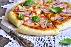 Pizza with smoked bacon. Stock Image