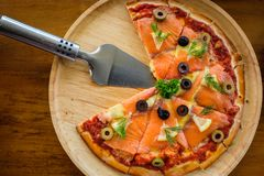 Pizza with smoked salmon Royalty Free Stock Image