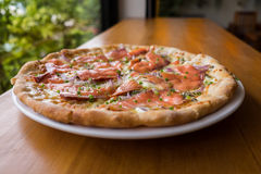 Pizza with smoked salmon Stock Photography