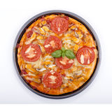 Pizza with smoked trout and tomato Royalty Free Stock Images