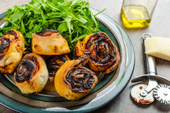 Pizza snails, minipizza with salad and parmagio Royalty Free Stock Photography