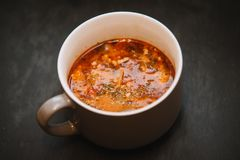 Pizza soup with meat, mushrooms, cheese, tomato and herbs Royalty Free Stock Photos