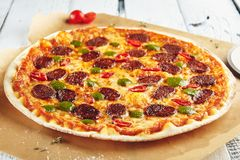 Pizza with spicy sausage Stock Photos