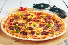 Pizza with spicy sausage Stock Image