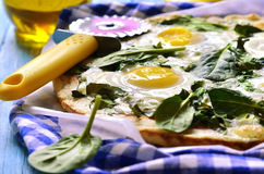 Pizza with spinach and fried eggs. Stock Images