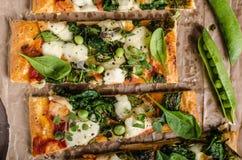 Pizza with spinach and mozzarella Stock Photo