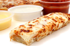 Pizza Sticks and Marinara Sauce, Garlic Sauce and Ranch Dressing. Take cheese pizza sticks with a container of marinara sauce, ranch dressing and garlic butter royalty free stock photography