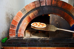 Pizza from stove Stock Image