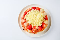 Pizza with strawberry and cheeses stock images