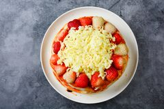 Pizza with strawberry and cheeses royalty free stock photo