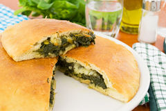 Pizza stuffed with spinach and cropping Royalty Free Stock Photography