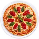 Pizza with Sun-dried tomatoes and Basil. Full circle of Pizza with Sun-dried tomatoes and Basil isolated over white background. Top view Royalty Free Stock Photos