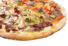 Pizza suprema aislada Imagen de archivo libre de regalías