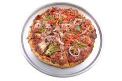 Pizza suprema de la cacerola foto de archivo libre de regalías