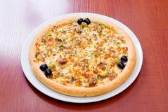 Pizza Supreme avec le poivre Photo libre de droits