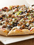 Pizza with supreme toppings Stock Images