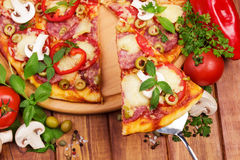 Pizza on table. Pizza with herbs and vegetables on table stock image
