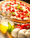Pizza. On the table with ingredients royalty free stock image
