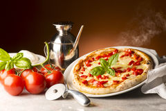 Pizza on the table. Pizza with ingredients on the table royalty free stock photo