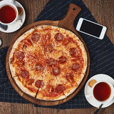 Pizza on table Royalty Free Stock Image