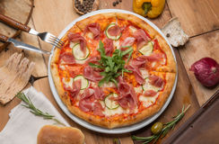 The pizza on the table and vegetables Royalty Free Stock Photo
