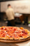 Pizza. Tasty hot  pizza on the white wooden table Royalty Free Stock Photography