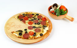 Pizza. A tasty salami pizza with plenty of vegetables royalty free stock images