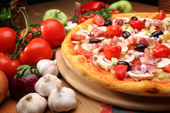Pizza. Tasty pizza with vegetables, mozzarela and tomato souce royalty free stock image