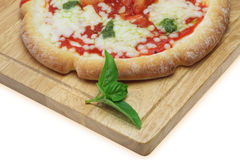 Pizza on th cutting board royalty free stock photo