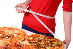 Pizza, thickness measurement of waist Royalty Free Stock Image