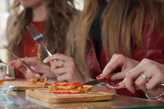 Pizza time and girl friends having good time Royalty Free Stock Image