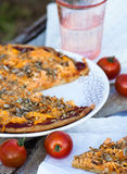 Pizza and tomato. On the board Stock Photography