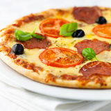 Pizza with tomato and salami Royalty Free Stock Photography