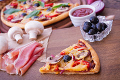 Pizza with tomato, salami and olives Royalty Free Stock Photography