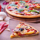 Pizza with tomato, salami and olives Stock Images