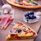 Pizza with tomato, salami and olives Stock Photos
