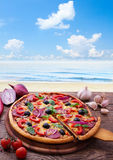 Pizza with tomato, salami and olives Stock Image