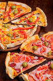 Pizza with tomato, salami, peppeeoni, olives and Royalty Free Stock Image
