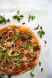 Pizza with tomato sauce, prosciutto and arugula. Perfect healthy lunch idea: Pizza with tomato sauce, prosciutto and arugula royalty free stock photos